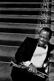 Louis Armstrong songs are known for their relaxed feel and great horn solos, as shown by Louis in this picture