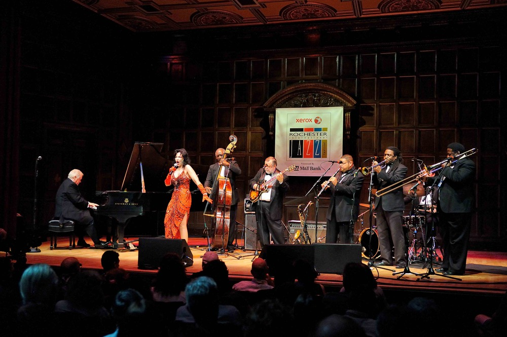 Full band, featuring vocalist Julie Jules. Pictured here on stage at the Xerox Rochester Jazz Festival, June 2013.