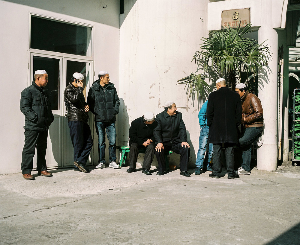 Men waiting for the beginning of the friday prayer at Shanghai Mosque