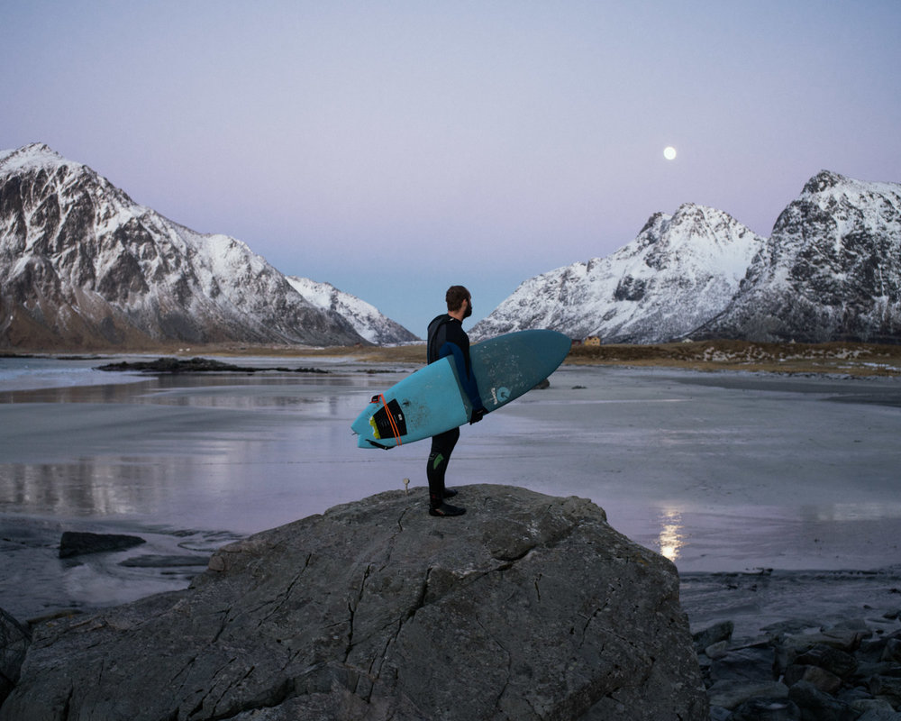 Tarjei Hansen, from Tromso is looking at moon rise on the Flakstad spot after a session in the waves