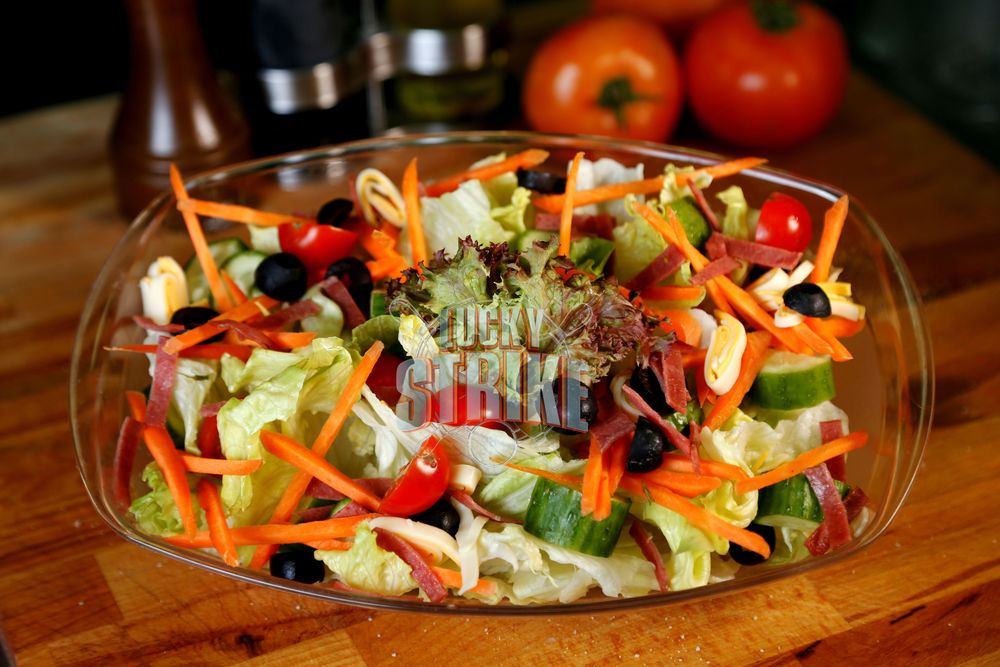 CHEF SALAD                                                                 25   A layered mix of freshly tossed romaine lettuce, mozzarella cheese, carrots, sliced olives, bacon, cucumber & red onion