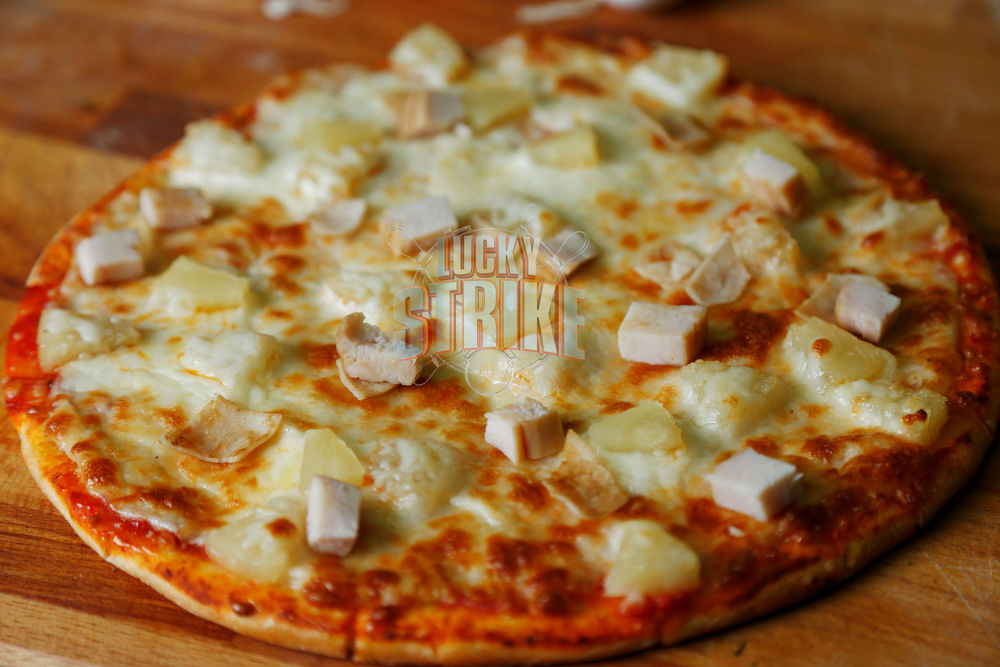 HAWAIIAN PIZZA                                                      38/49    Freshly homemade dough topped with   turkey breast, pineapple & melted mozzarella cheese & I  talian sauce