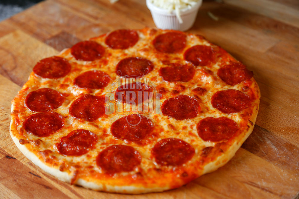 PEPPERONI PIZZA                                                     38/49    Freshly homemade dough topped with   beef pepperoni, melted mozzarella cheese & I  talian sauce
