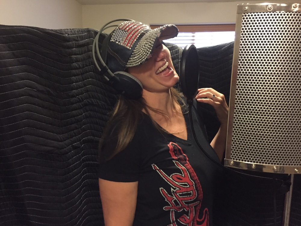 Sunny Jackson, lead vocalist for Prairie Fire in Kearney, lays down vocal tracks in May for their upcoming EP of originals and cover songs.