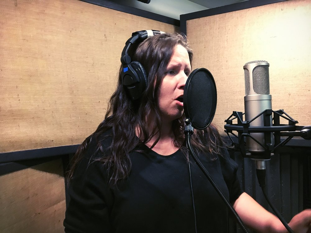 Nicole Hoffmeister recording vocals for two classical pieces at A NOTE-Worthy Studio in Kearney, Nebraska in summer 2017.