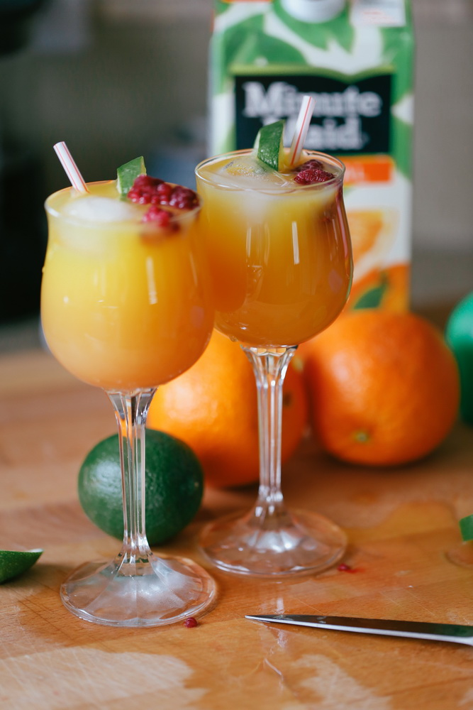 Directions:   - Chill glasses and add ice  - Pour 1 oz lime juice.  Add orange juice, then top up with cranberry juice.  - Add colourful fruit.   - Enjoy