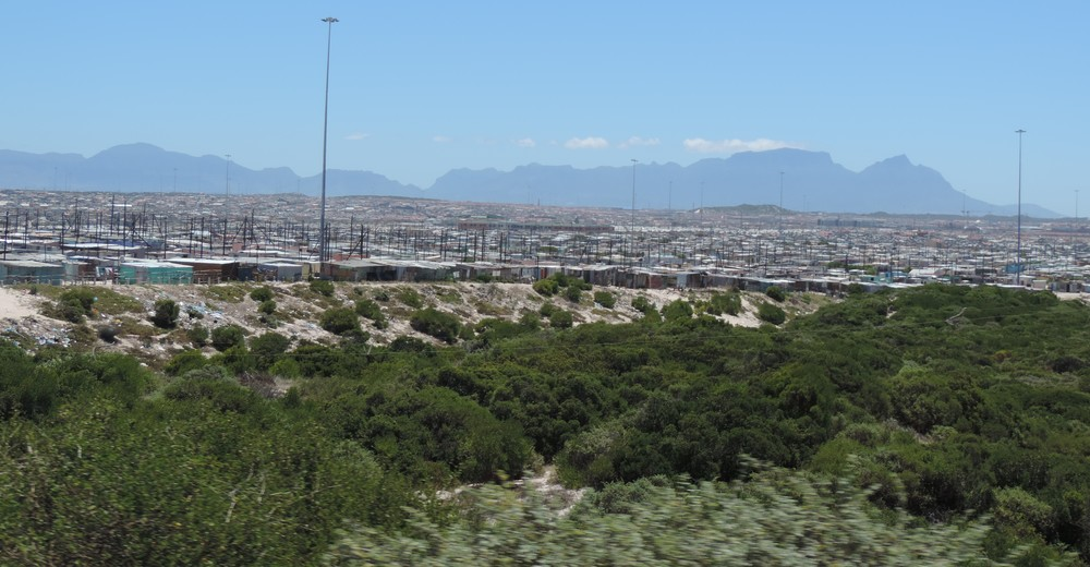 Khayelitsha Township — An expansive vista of shanties that stretch endlessly on as viewed from the road.
