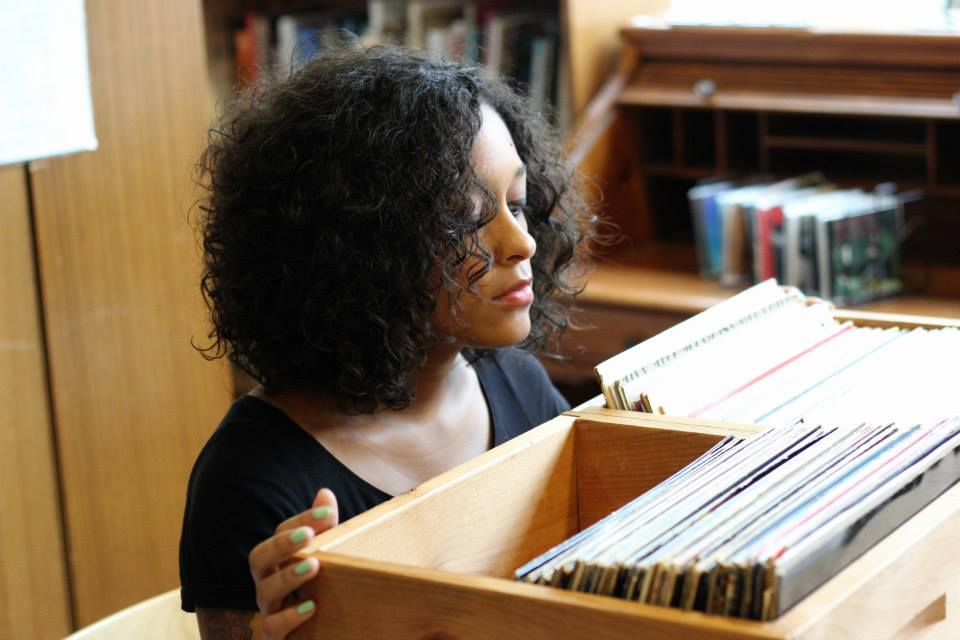 Photo of Eve L. Ewing in record store