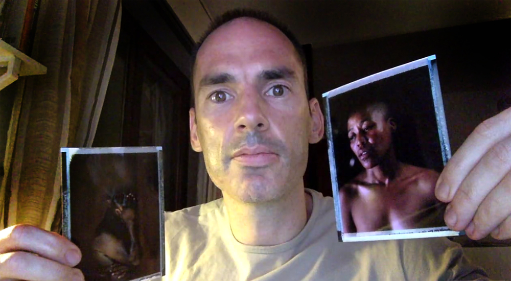 Robin Hammond holds his images of Buje from Nigeria (viewer's left) and Milli from South Africa (viewer's right), both part of his Where Love is Illegal portfolio.