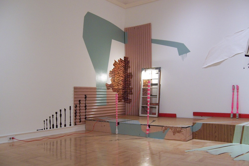 Questioning the Fabric of Reality (left view) 2008 site-specific installation at Henry Art Gallery, 26x8x10 ft, wood, paint, found objects, tape, vinyl, light