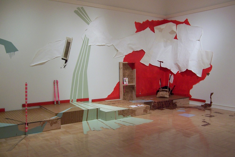 Questioning the Fabric of Reality (right   view) 2008 site-specific installation at Henry Art Gallery, 26x8x10 ft, wood, paint, found objects, tape, vinyl, light