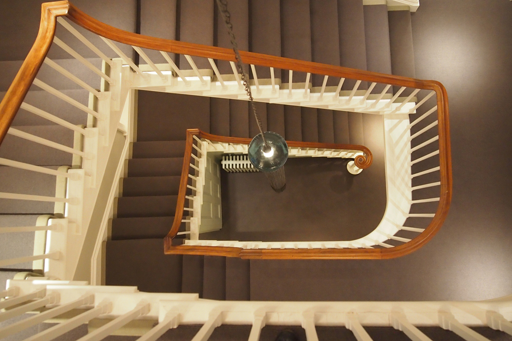 stairwell with Locomotion steam light fitting
