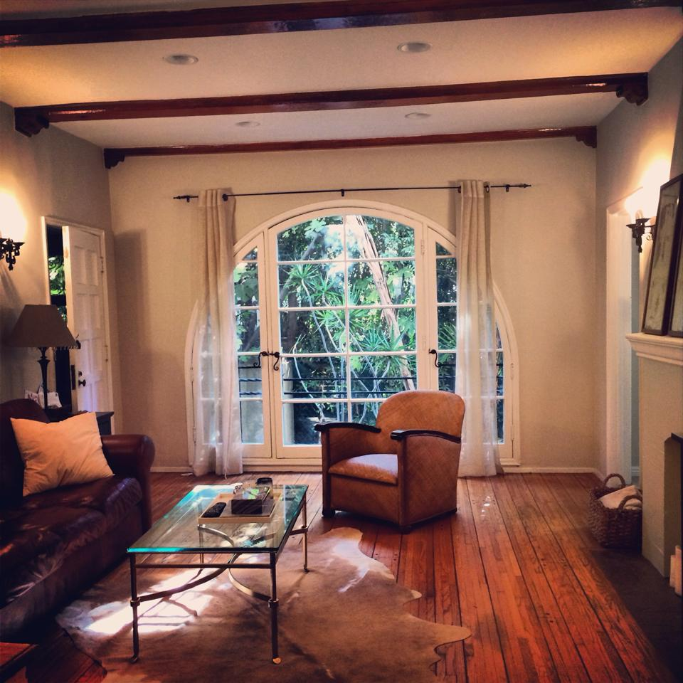Great arched picture window with beamed ceilings and original peg 'n groove hardwood floors