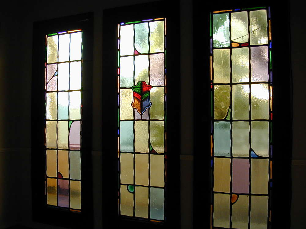 Many original leaded glass doors and windows, this is a triple door in dining room to a step-out balcony, facing north