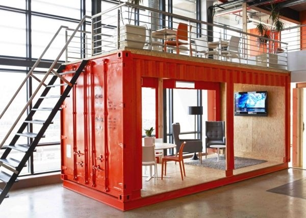 The conference room of the Cape Town advertising firm 99c, designed by Inhouse Brand Architects is made out of a bold red shipping container, and has additional seating on top of the room.