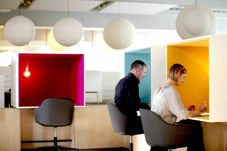 The cubicles at the Vitra headquarters in Weil am Rhein, Germany, do not take up any more space than an open desk set-up. Additionally, the different colors of the interior lining allow for personalization.