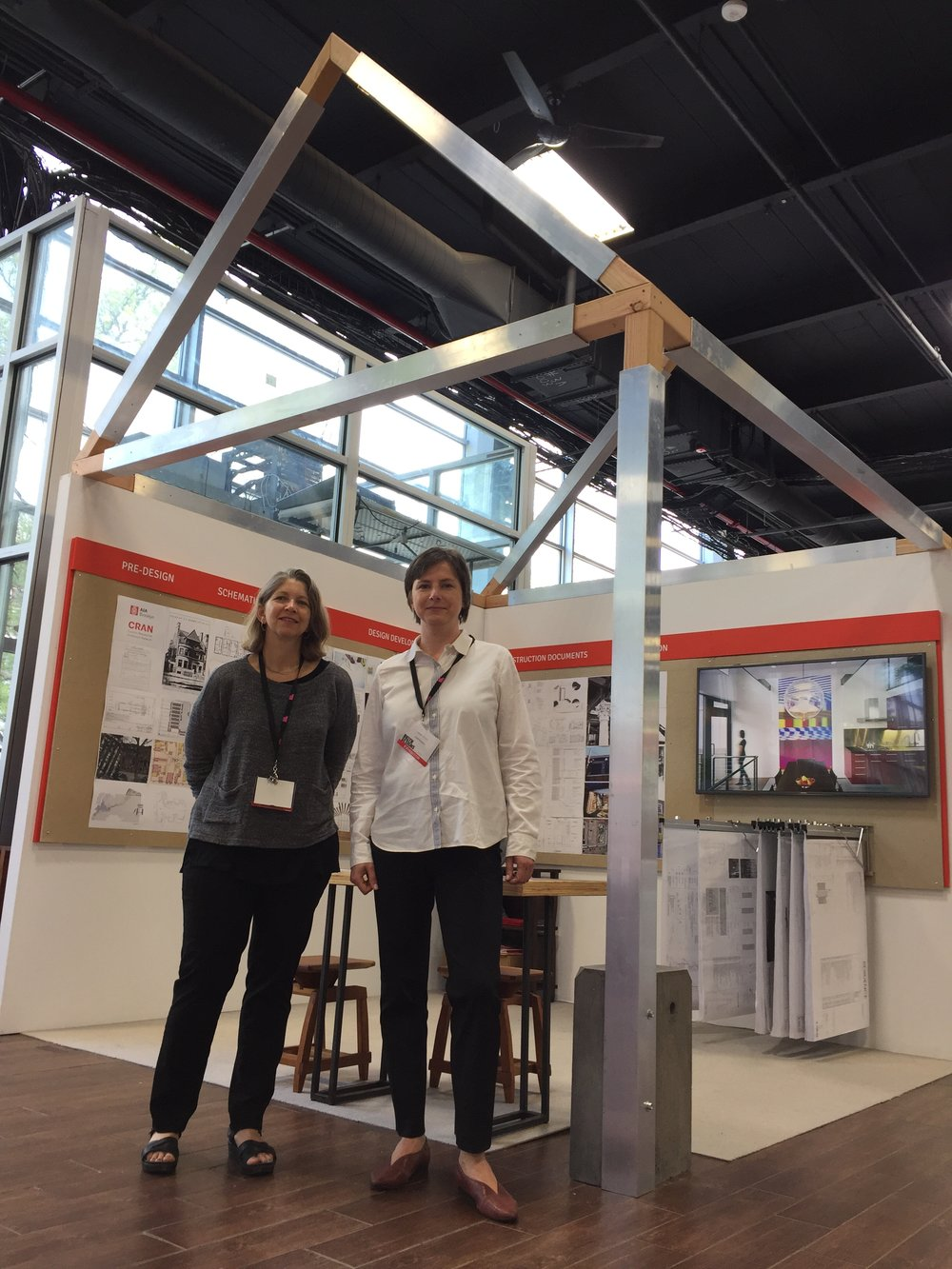 Ula Bochinska of Bostudio with colleague Kimberly Neuhaus of Neuhaus Design Architecture in front of the Brooklyn CRAN AIA booth.