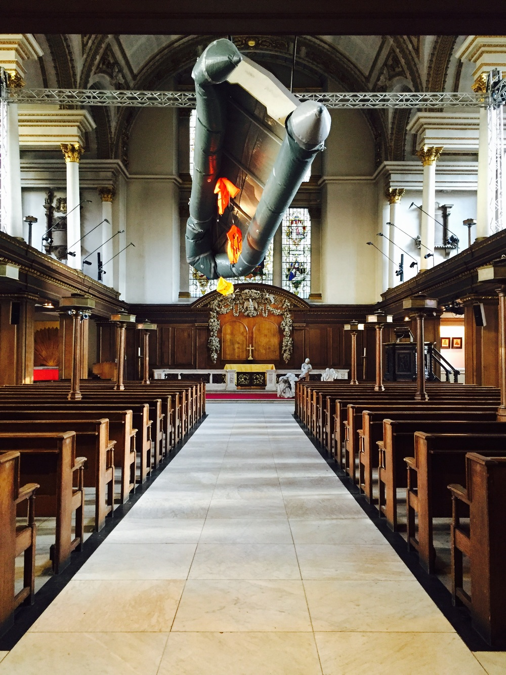This is St James's in London's Piccadilly Circus, where the artist Arabella Dorman hung an actual refugee dingy from the rafters as literal reminder of the tragedy of people looking for sanctuary. Read more about the installation called  Flight  on    BBC.