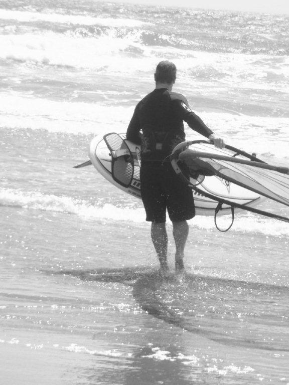 Pete Waihi B&W with wsf walking into water.jpg