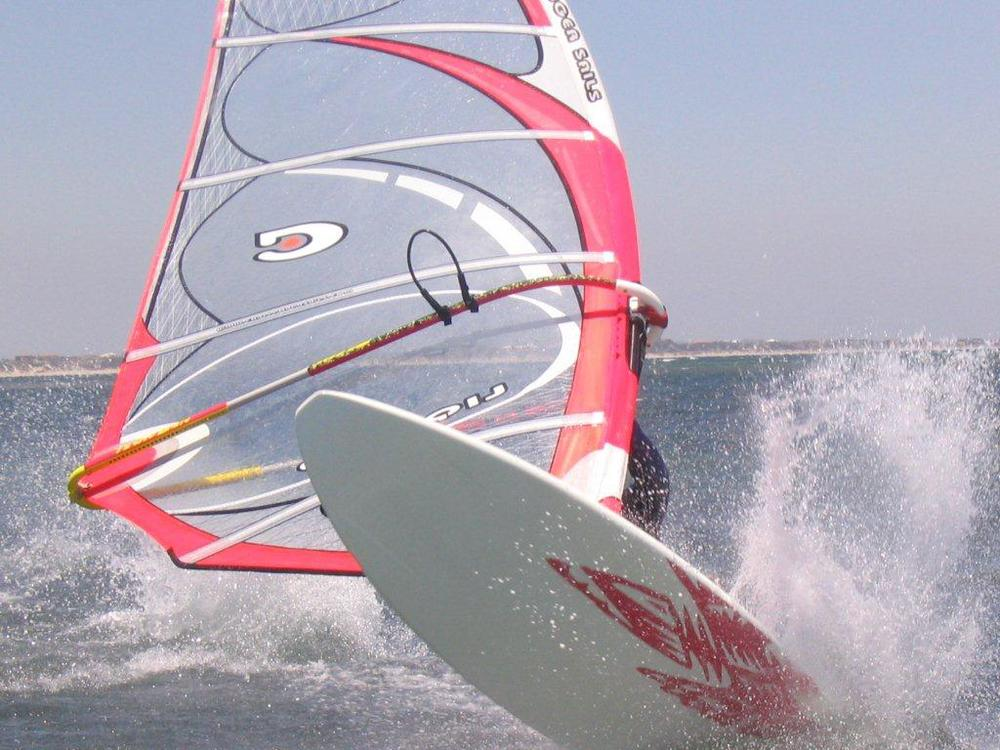 pink sail into the gybe.jpg