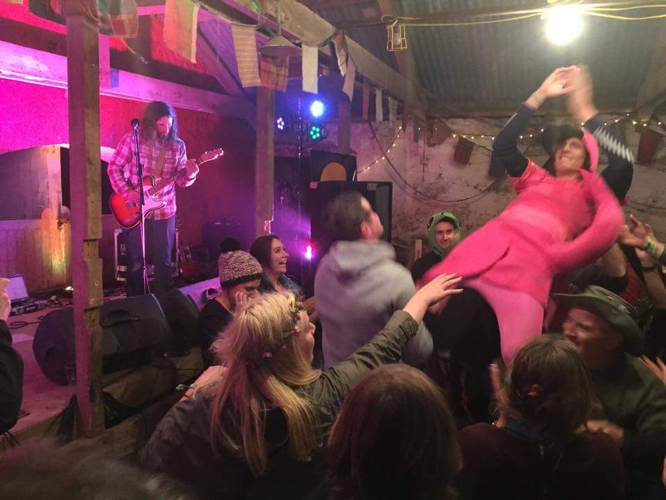 Closing Jocktoberfest, with a man dressed in a pink flamingo suit crowd surfing
