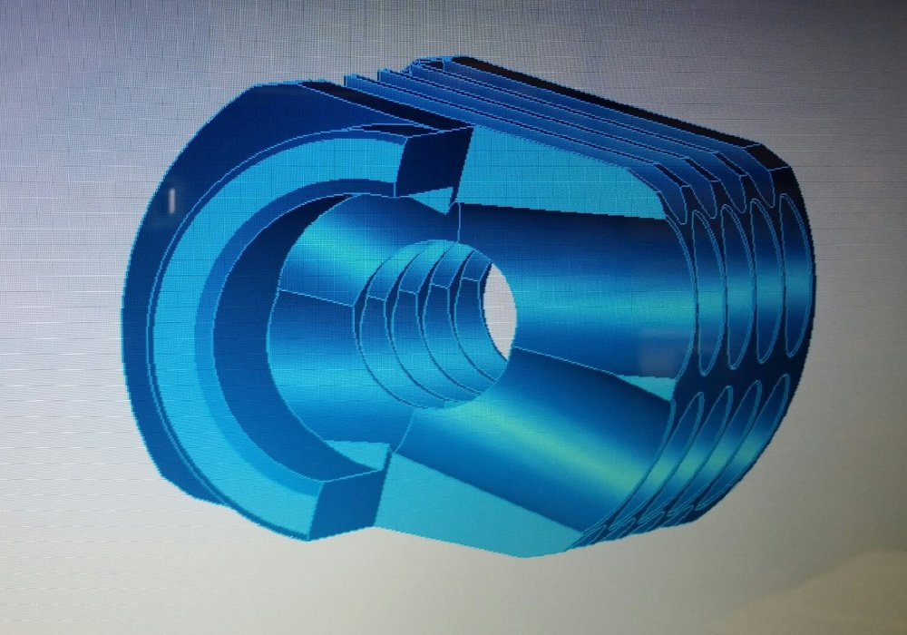 """Partial sectional displays middle/right cutting edge of first expansion chamber. Designed to """"shave"""" expanding gas into radial surface of the ports for maximum efficiency redirecting gas."""