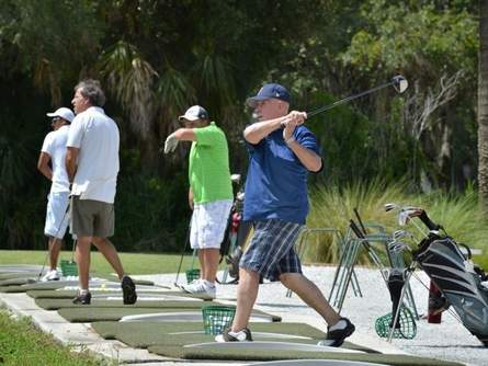 Don Perron, right, of Sarasota, practices for a tournament in September at Bobby Jones Golf Club in Sarasota. A local not-for-profit group, Friends of Bobby Jones Golf Club, is making a plea to the city for improvements at the only municipal golf course in Sarasota. Photograph by Mike Lang courtesy of Sarasota Herald-Tribune.