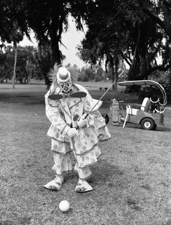 Circus Clown  Paul Jerome  takes a break from the Ringling Brothers and Barnum & Bailey Combined Shows Winter Headquarters across the street from  Bobby Jones Golf Club  in 1960. Photograph  by Joseph Janney Steinmetz, courtesy of the Steinmetz Collection of the State Library and Archives of Florida.