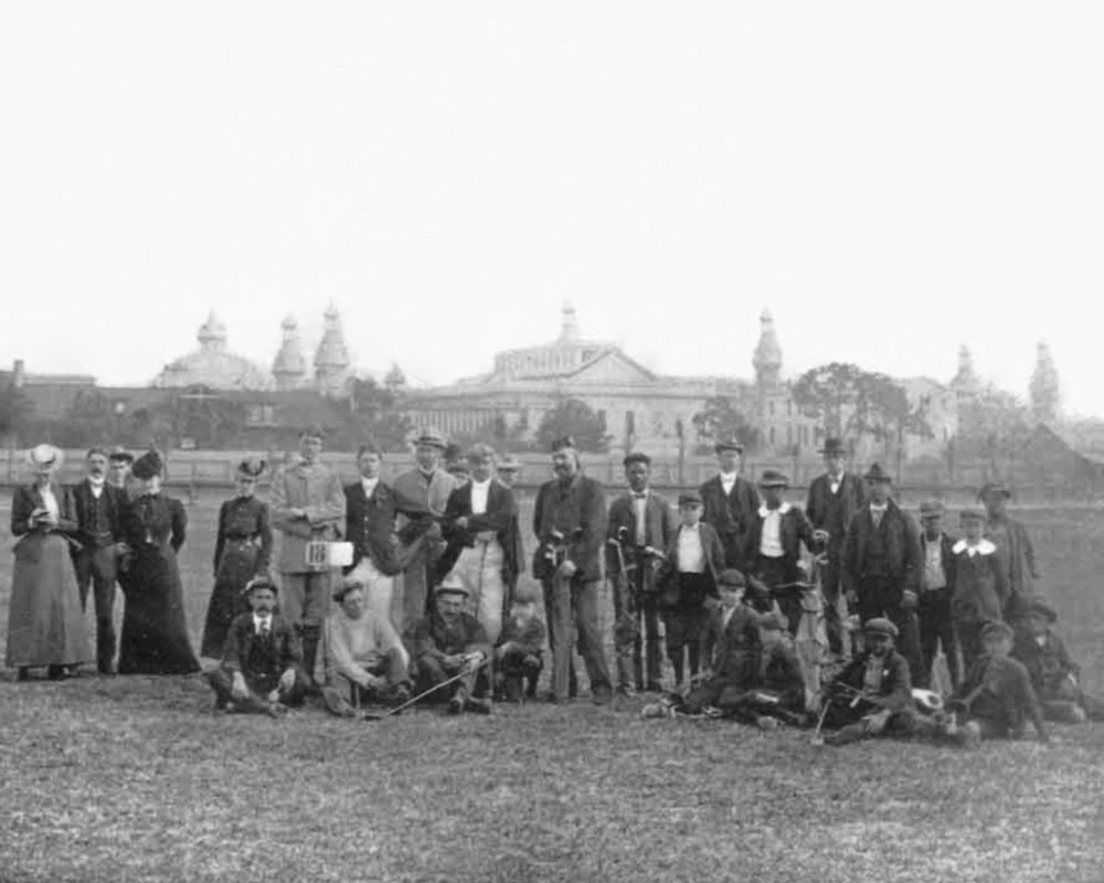 At the Tampa Bay Golf Club, 1900.  John Hamilton Gillespie , standing center, with his golf clubs.