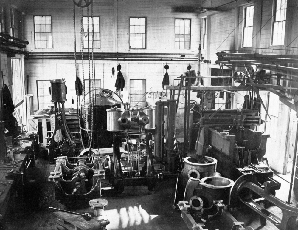 Herreshoff Manufacturing Company machine shop Circa 1880s. Several sizes of compound steam engines and a coil-type boiler being assembled.