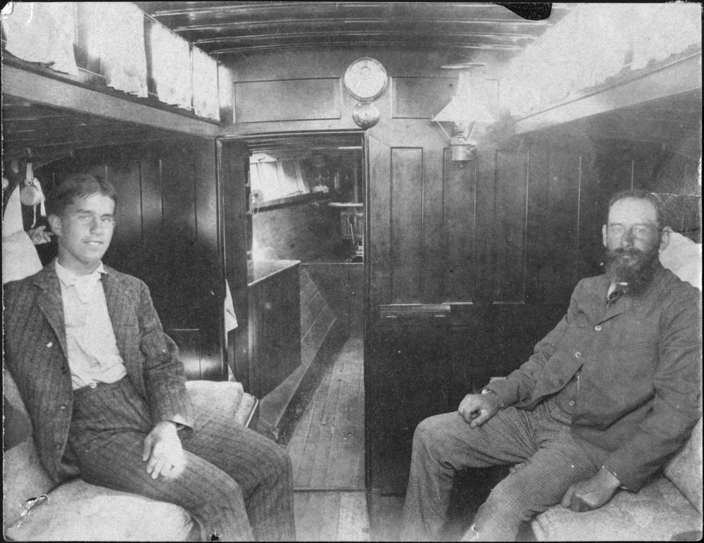 Lucian Sharpe and Capt. Nat (right) in  Clara's  cabin, photo by George Owen.