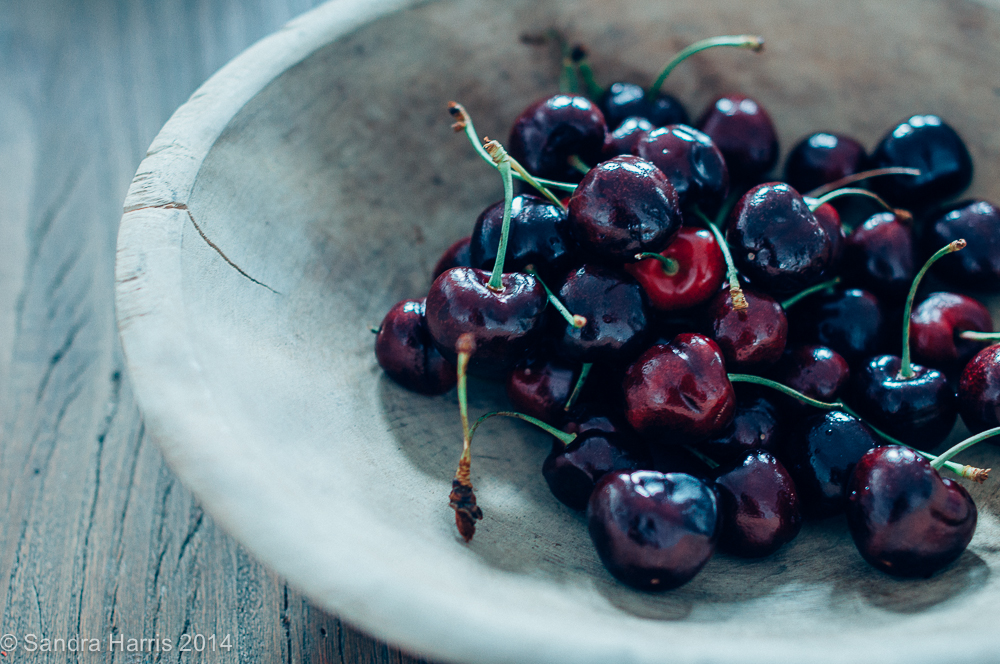 bing cherries in a vintage wooden bowl - Sandra Harris