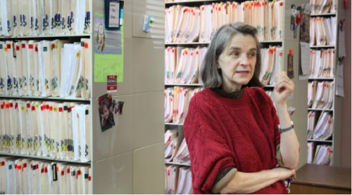 """A physician stands in front of her paper-based filing system in 2013. Image credit: Kristofor Husted, via Marketplace                 0    0    1    19    113    Princeton    1    1    131    14.0                          Normal    0                false    false    false       EN-US    JA    X-NONE                                                                                                                                                                                                                                                                                                                                                                                                                                                                                                                                                  /* Style Definitions */ table.MsoNormalTable {mso-style-name:""""Table Normal""""; mso-tstyle-rowband-size:0; mso-tstyle-colband-size:0; mso-style-noshow:yes; mso-style-priority:99; mso-style-parent:""""""""; mso-padding-alt:0in 5.4pt 0in 5.4pt; mso-para-margin:0in; mso-para-margin-bottom:.0001pt; mso-pagination:widow-orphan; font-size:12.0pt; font-family:Cambria; mso-ascii-font-family:Cambria; mso-ascii-theme-font:minor-latin; mso-hansi-font-family:Cambria; mso-hansi-theme-font:minor-latin;}"""