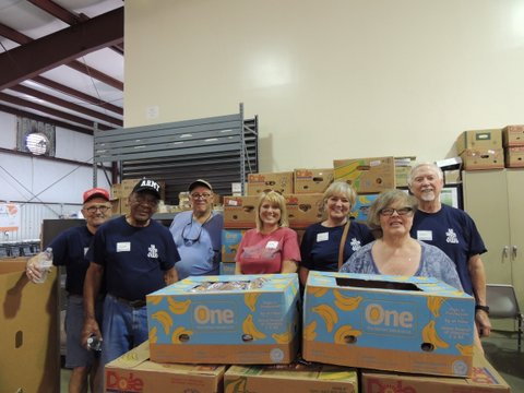 Cann members working at the Food Bank of the Albemarle