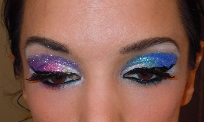 Here are two different glitter eye makeup looks that I will be breaking down today.           Glitter Eyeshadow Tutorial      This is a look I used to do all the time  and got lots of requests on how to do it but it was always hard to  explain without pictures. I decided to do this one first, because  despite looking complicated I actually think this is the easier of  eyemakeups to do. The glitter works with the natural contours of your  eye making it no neccesary to be absolutely perfect at shading. So  without further adieu, here is a brief tutorial on how to do full  glitter eyemakeup.      You will need:      1- 2-3 glitter colors.     I suggest an iridescent clear, a primary  color (red, blue, yellow or pink, pale blue, pale yellow) and a color  that is a combination of your primary with anoter (purple, green, orange  etc) I prefer using paler glitters over dark glitters. The dark  glitters are not as shiny and are a little aggressive in my opinion. You  also do just one color, green and darker green for example. Clare's has  a nice glitter set or you can go to a craft store, just be wary,  glitter can really aggrevate eyes, especially contact lens wearers.     2- Your favorite eyeshadow primer (not neccesary but will preserve your look all night)     3- Eyelash glue (the rubber cementy type,  not the liquid) I have heard of other eyeshadow adhesives but they all  seem terribly expensive and this works and is cheap     4- Fake eyelashes     5- Complimentary colored eyeshadows to your glitters     6- Liquid or gel black liner     7- Mascara, Eyebrow pencil      Steps:        1- First come up with a game plan before  you start and lay out everything. Everything moves very quickly once you  start up. For show makeup I like to do a a white and pale color on my  lid, a medium on my crease and a dark on my corner so I use this same  idea for the glitter. Use whatever color scheme you like best.