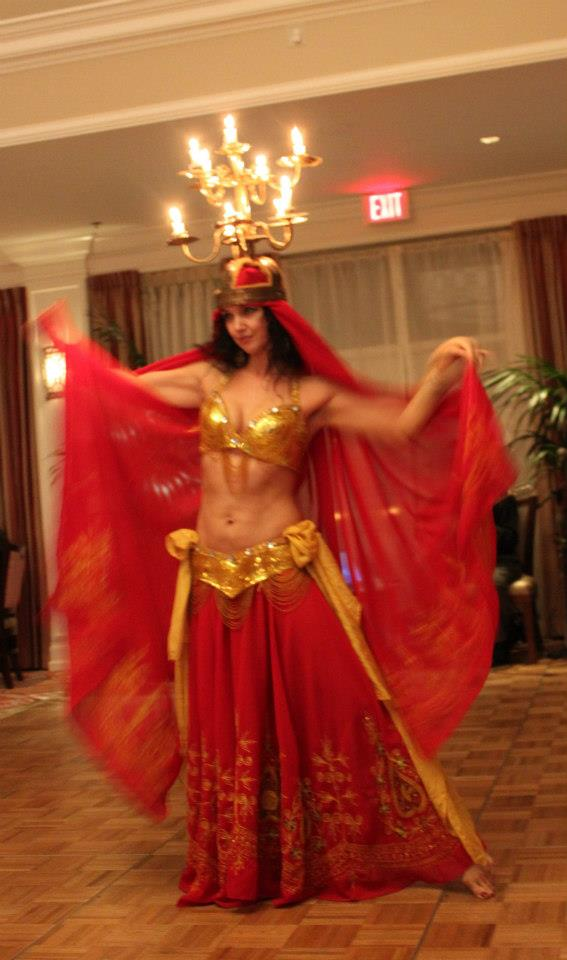 Dawn of Belly dance Sirens and Imperial Bellydance performing a shamadan show at Greek Night in Boynton Beach