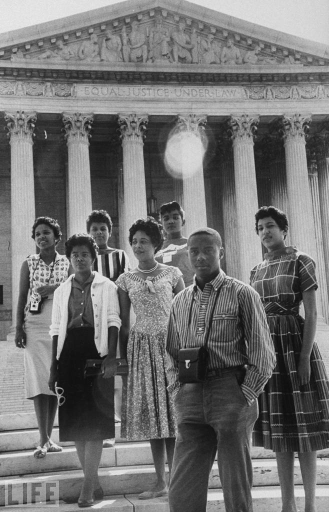 Daisy Bates  (center) posing in front of the U.S. Supreme Court building with six of the nine African American students who integrated Little Rock (Central) High School. Represented by Mr. Carter and Pine Bluff, Arkansas native  George Howard, Jr. , Bates would later successfully challenge Little Rock and North Little Rock ordinances that demanded city officials be provided with a list of names of the members of the local branch of the NAACP. The U.S. Supreme Court held the ordinances unconstitutionally infringed on the freedom of association.   See Bates v. City of Little Rock , 361 U.S. 516, 80 S. Ct. 412, 4 L. Ed. 2d 480 (1960) .