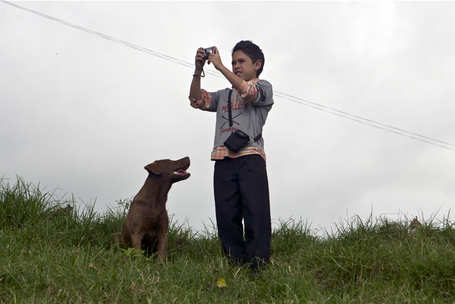 Miguelito w camera and dog.jpg