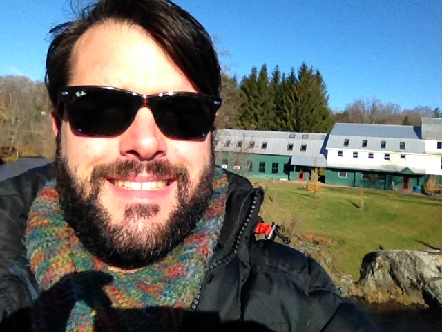 Oh hey, that's my studio behind me...yeah the huge one next to the river.