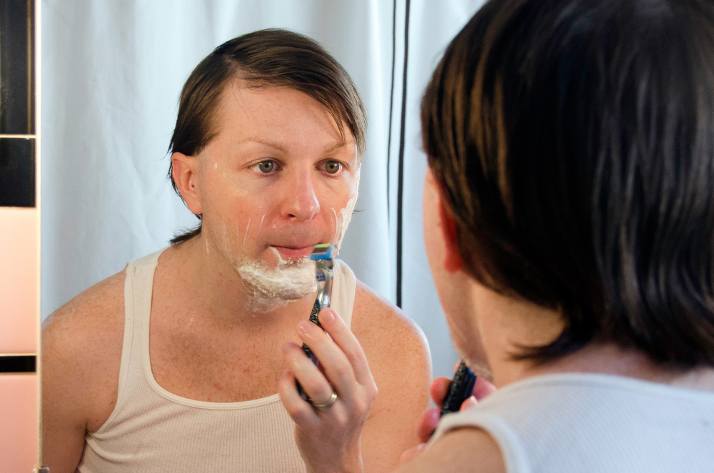 Johnson shaves his face in preparation for his performance on March 9, 2014.