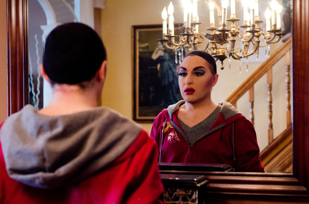 Johnson admires his transformation into his drag queen alter-ego, Stella D'Oro, in his living room mirror on January 19, 2014.