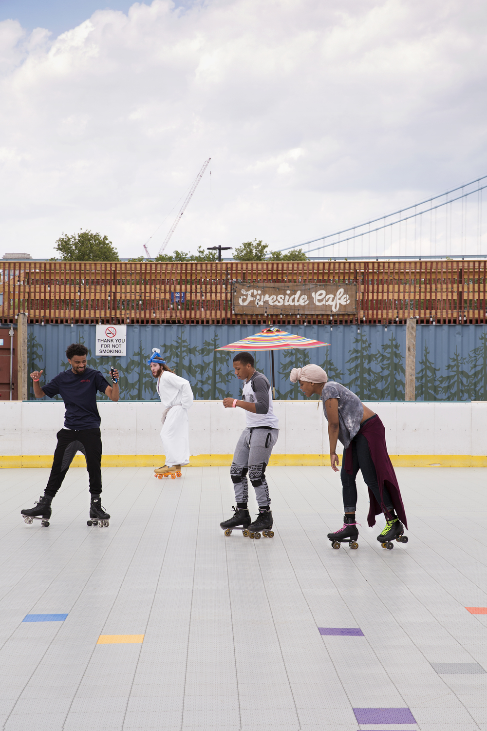 """Michael """"Philly Jesus"""" Grant (second to left) dons a balloon hat and goes rollerskating at the Spruce Street Harbor Park on May 22, 2015."""