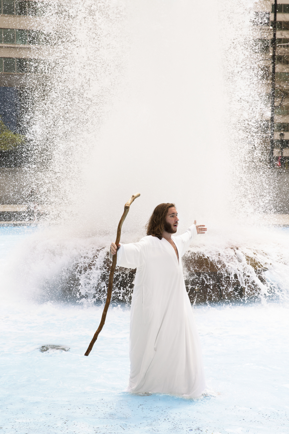 """Michael """"Philly Jesus"""" Grant demonstrates his (in)ability to walk on water in Philadelphia's Love Park fountain on April 17, 2015."""