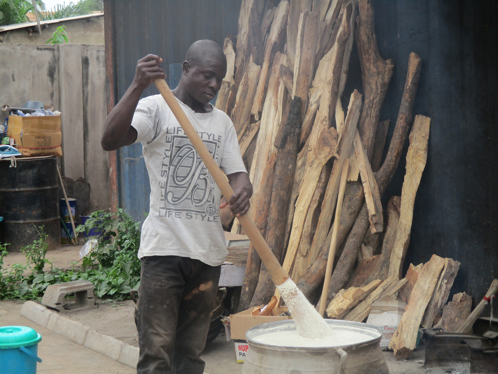 A cook stirring banku is captured by  Eugenia, Form 1.