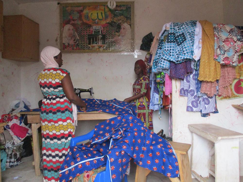 A glimpse into a local seamstress' shop by  Palmer, Form 1.