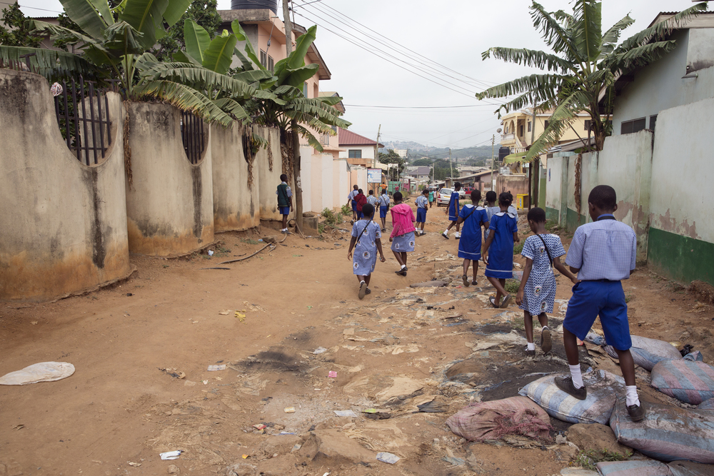 The kids walk back to school along a back street in Alhaji.