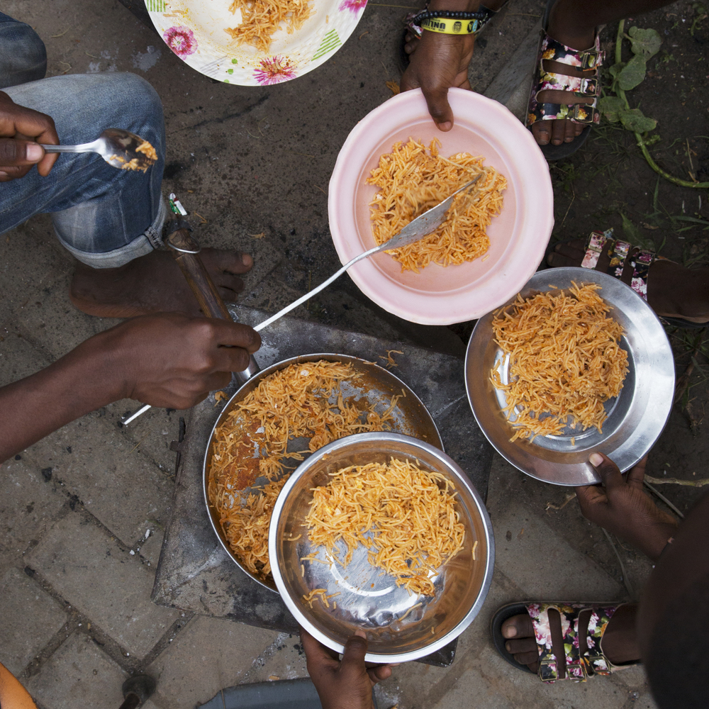 "Precious dolls out ""jollof spaghetti"" to the other boarding students."