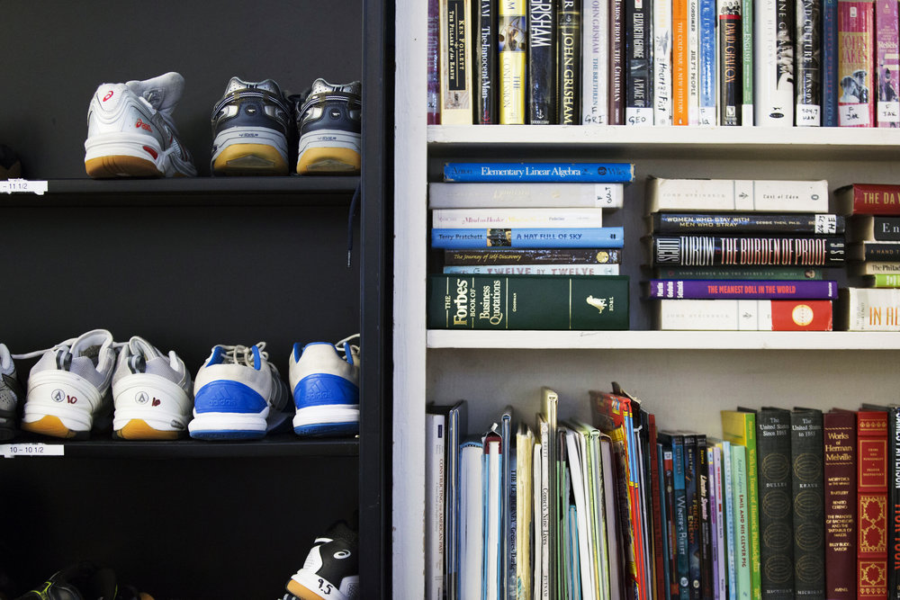 Sneakers and books are stored side by side at the SquashSmarts facility in North Philadelphia on May 2. At SquashSmarts, both athletic and academic items are made available for student use, including clothing, equipment, reading materials and desktop computers. In each after-school session, students receive one hour of academic mentorship, including homework help, studying tips and assistance with private high school and college applications, plus one hour of athletic training (squash).