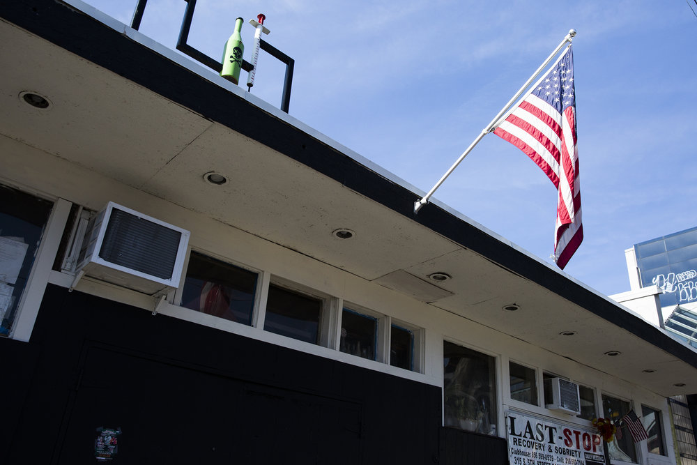 The exterior of The Last Stop recovery and sobriety center is seen decorated with an American flag and a needle and bottle adorned with a skull and cross bones on February 19, 2019.