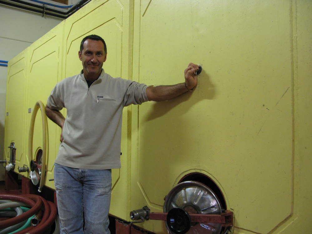 Mauro Altini with his traditional glass-lined cement tanks